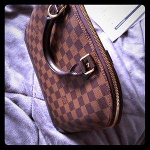 A purse Louis Vuitton